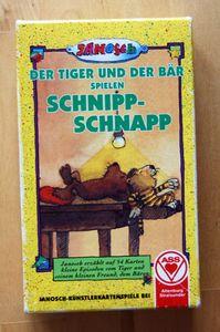 Der Tiger und der Bär spielen Schnipp-Schnapp