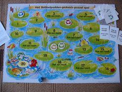 Het Babbelpadden-picknick-puzzel spel